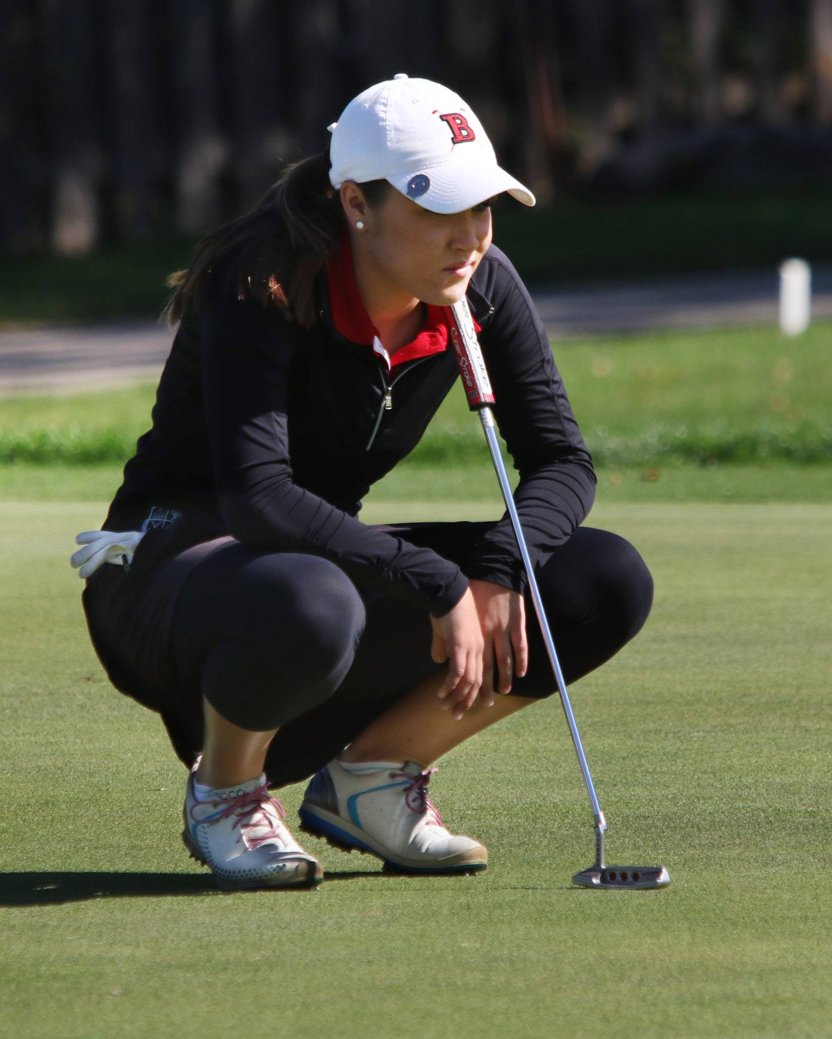 Barrington's Nicole Ciskowski, here lining up a putt during sectional play last season, had the low score in the state-qualifying tournament hosted by Barrington on Monday.