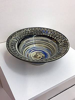 "A ceramic bowl, ""A Cut Above,"" by Cyndi Hicks of Woodstock is on display at ""Not Yet,"" student ceramics show at the Satellite Gallery in the Old Woodstock Courthouse."
