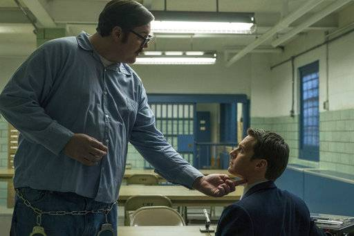 "This image released by Netflix shows Cameron Britton, left, and Jonathan Groff in a scene from the 10-episode series, ""Mindhunter,"" streaming on Netflix starting Friday. (Merrick Morton/Netflix via AP)"