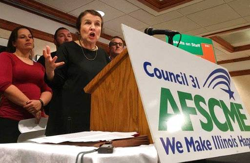 American Federation of State, County and Municipal Employees (AFSCME) Council 31 Executive Director Roberta Lynch speaks at a news conference Thursday, Oct. 12, 2017, in Springfield, Ill. The union representing corrections officers says inmate attacks on state employees have increased 51 percent since 2015. AFSCME says the Illinois Department of Corrections is reclassifying violent inmates to lower security levels to save money. Those inmates are transferred to medium-security prisons which are less costly to run.