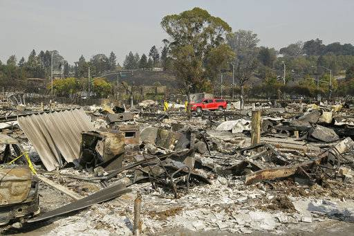 Shown are the remains of where Linda Tunis lived at the Journey's End mobile home park Wednesday, Oct. 11, 2017, in Santa Rosa, Calif. Jessica Tunis is searching for her missing mother, Linda Tunis, who was living at the mobile home park when the wildfires struck.