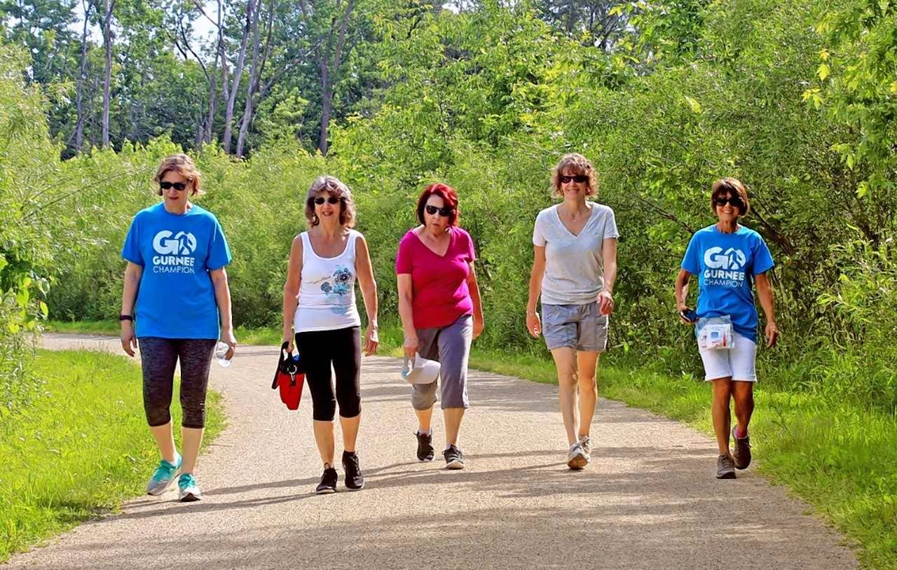 Members of the Gurnee GO walking club traverse the Des Plaines River Trail.