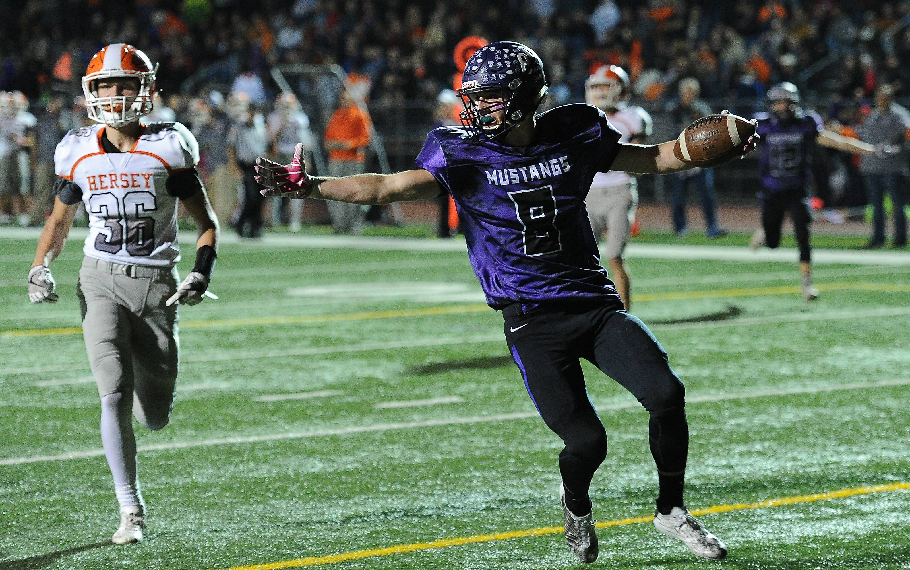 Rolling Meadows' Gregory Bouraoui scores a first-half touchdown past Hersey's Jordan Hansen.