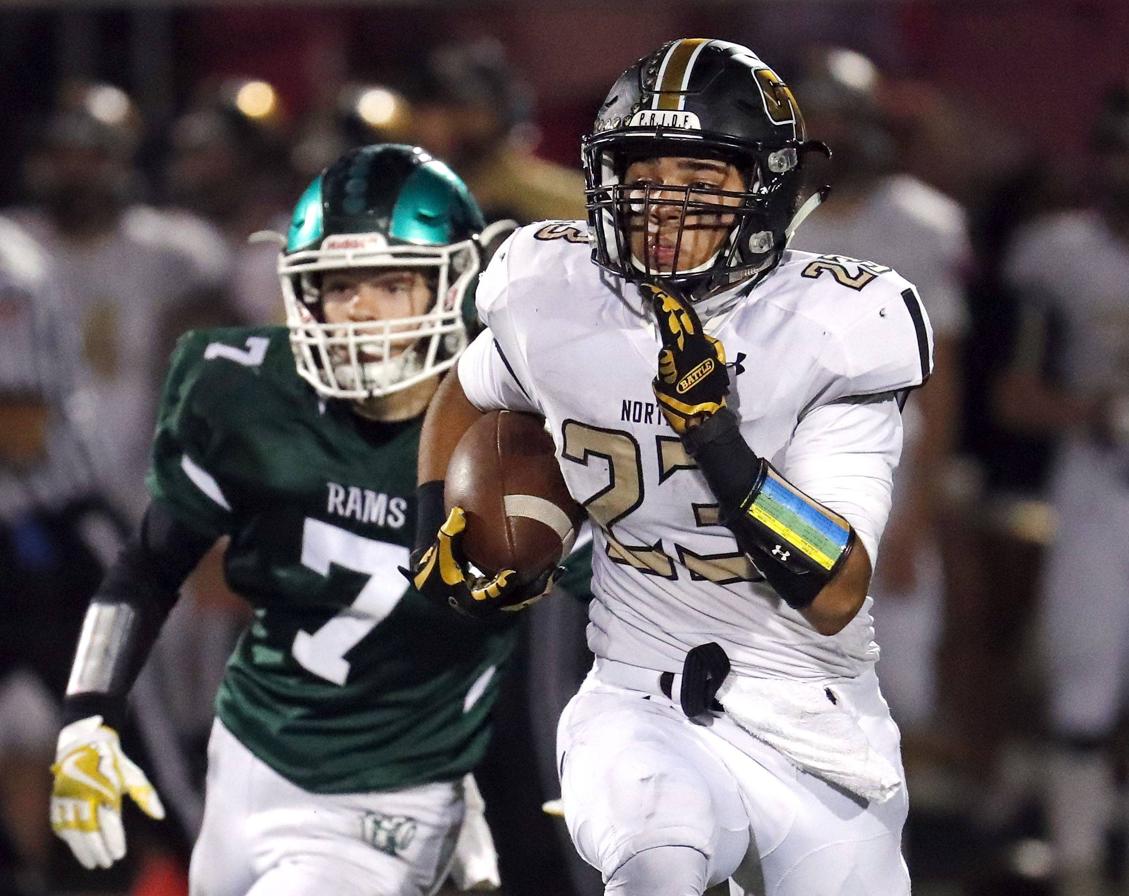 Grayslake North's Jordan Curtis, right, gets past Grayslake Central's Kirk Comerford.