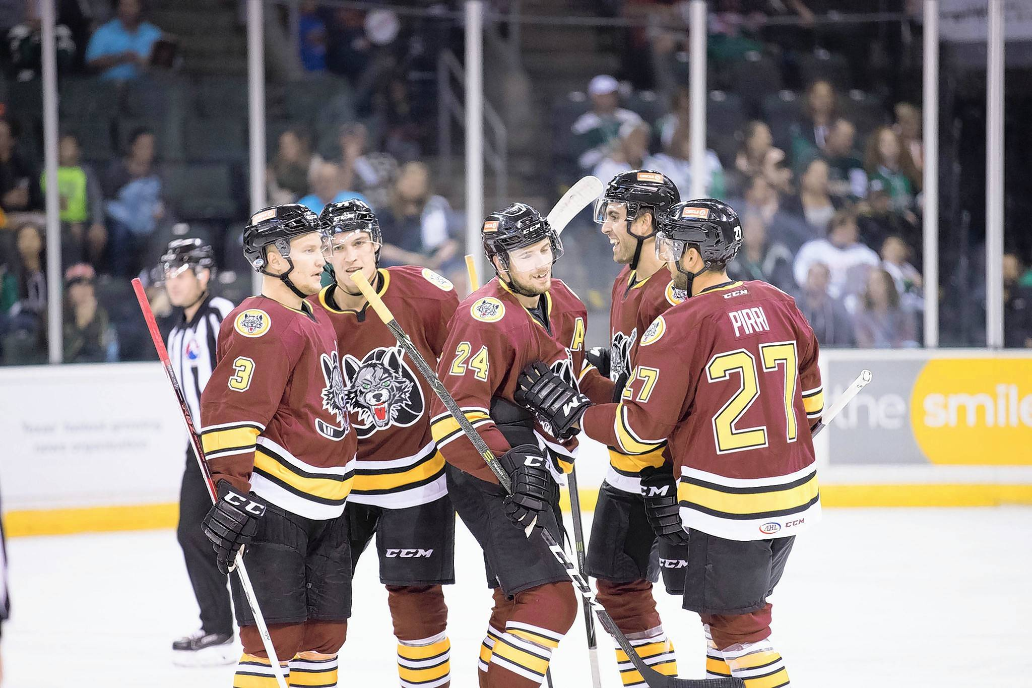 Chicago Wolves players Teemu Pulkkinen, left, Beau Bennett, Shea Theodore, Alex Tuch and Brandon Pirri celebrate a Theodore power-play goal on Oct. 7 at Texas.