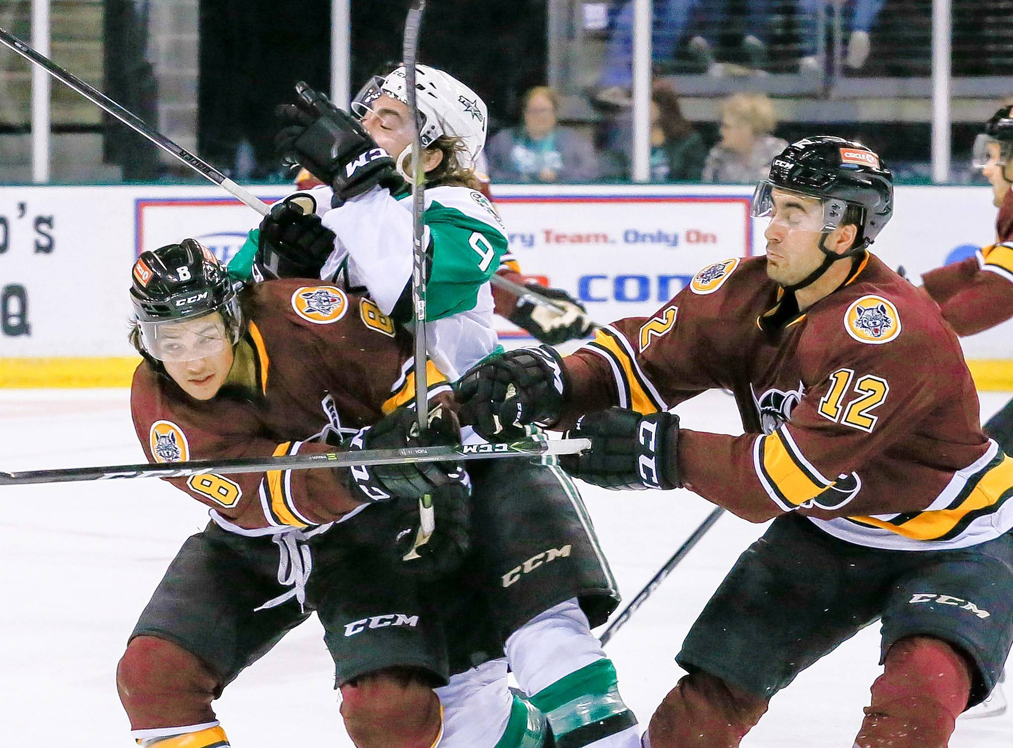 Photo courtesy of the Texas StarsChicago Wolves rookie forward Tyler Wong, left, and Alex Tuch sandwich the Texas Stars' Remi Elie.
