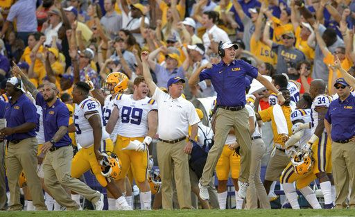 The LSU sideline erupts in celebration after a touchdown by wide receiver D.J. Chark during the second half of an NCAA college football game against Auburn in Baton Rouge, La., Saturday, Oct. 14, 2017. LSU defeated Auburn 27-23.