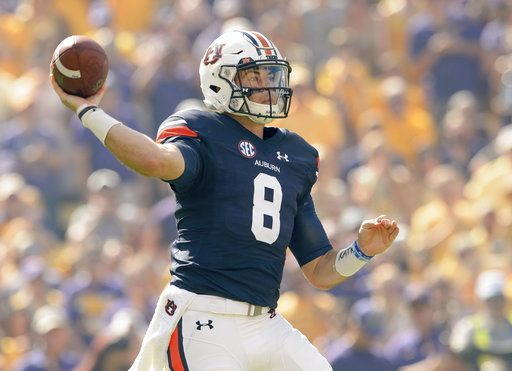 Auburn quarterback Jarrett Stidham (8) throws against LSU in the first half of an NCAA college football game in Baton Rouge, La., Saturday, Oct. 14, 2017.