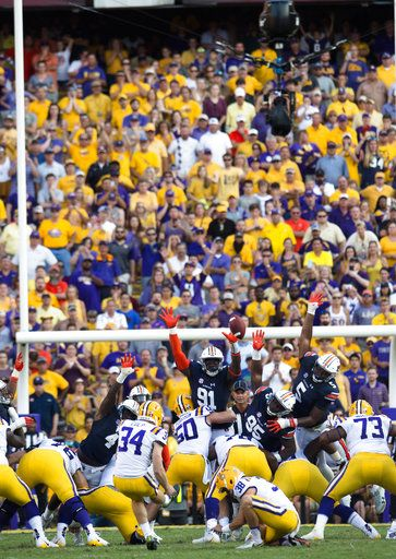 LSU place kicker Connor Culp (34) kicks a field goal giving LSU its first lead of the game against Auburn in the second half of an NCAA college football game against Auburn in Baton Rouge, La., Saturday, Oct. 14, 2017. LSU punter Josh Growden (38) holds for Culp. LSU won 27-23. (Albert Cesare/The Montgomery Advertiser via AP)