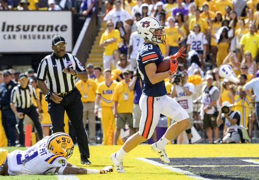 LSU safety Grant Delpit (9) can't stop Auburn wide receiver Will Hastings (33) from scoring a touchdown in the first half of an NCAA college football game in Baton Rouge, La., Saturday, Oct. 14, 2017.