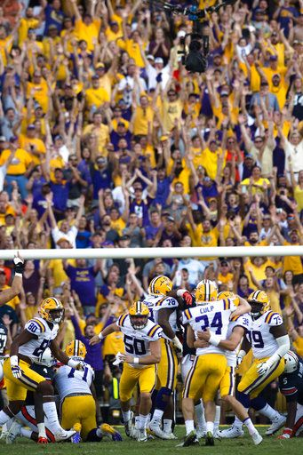 LSU place kicker Connor Culp (34) celebrates with Josh Growden (38) after kicking a field goal giving LSU its first lead of the game against Auburn in the second half of an NCAA college football game against Auburn in Baton Rouge, La., Saturday, Oct. 14, 2017. LSU won 27-23. (Albert Cesare/The Montgomery Advertiser via AP)