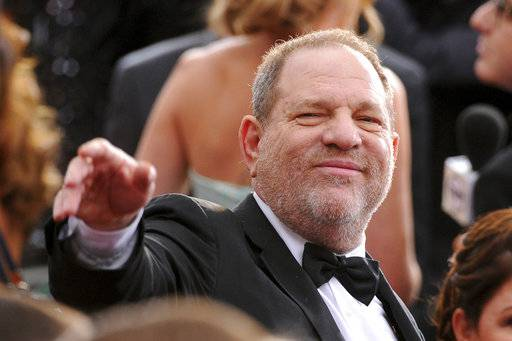 FILE- In this Feb. 22, 2015 file photo, Harvey Weinstein arrives at the Oscars at the Dolby Theatre in Los Angeles. On Saturday, Oct. 14, 2016, the Academy of Motion Picture Arts and Sciences revoked Weinstein's membership. The decision, reached Saturday in an emergency session, comes in the wake of recent reports by The New York Times and The New Yorker magazine that revealed sexual harassment and rape allegations against him going back decades.(Photo by Vince Bucci/Invision/AP, File)