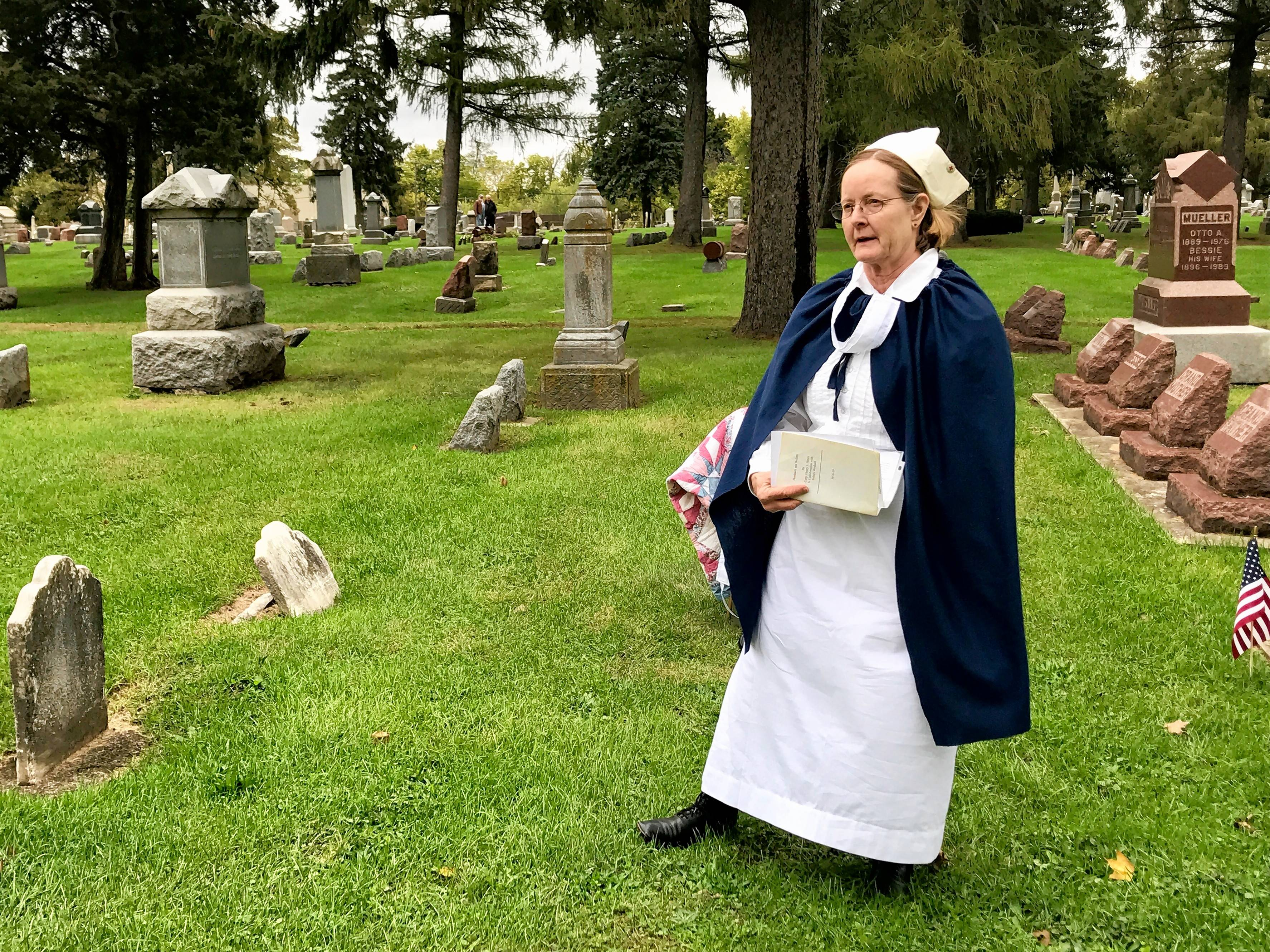 Kristie Benedik of Carpentersville portrays Red Cross nurse Caroline Steinwart during the Dundee Township Historical Society's cemetery walk Sunday in West Dundee.