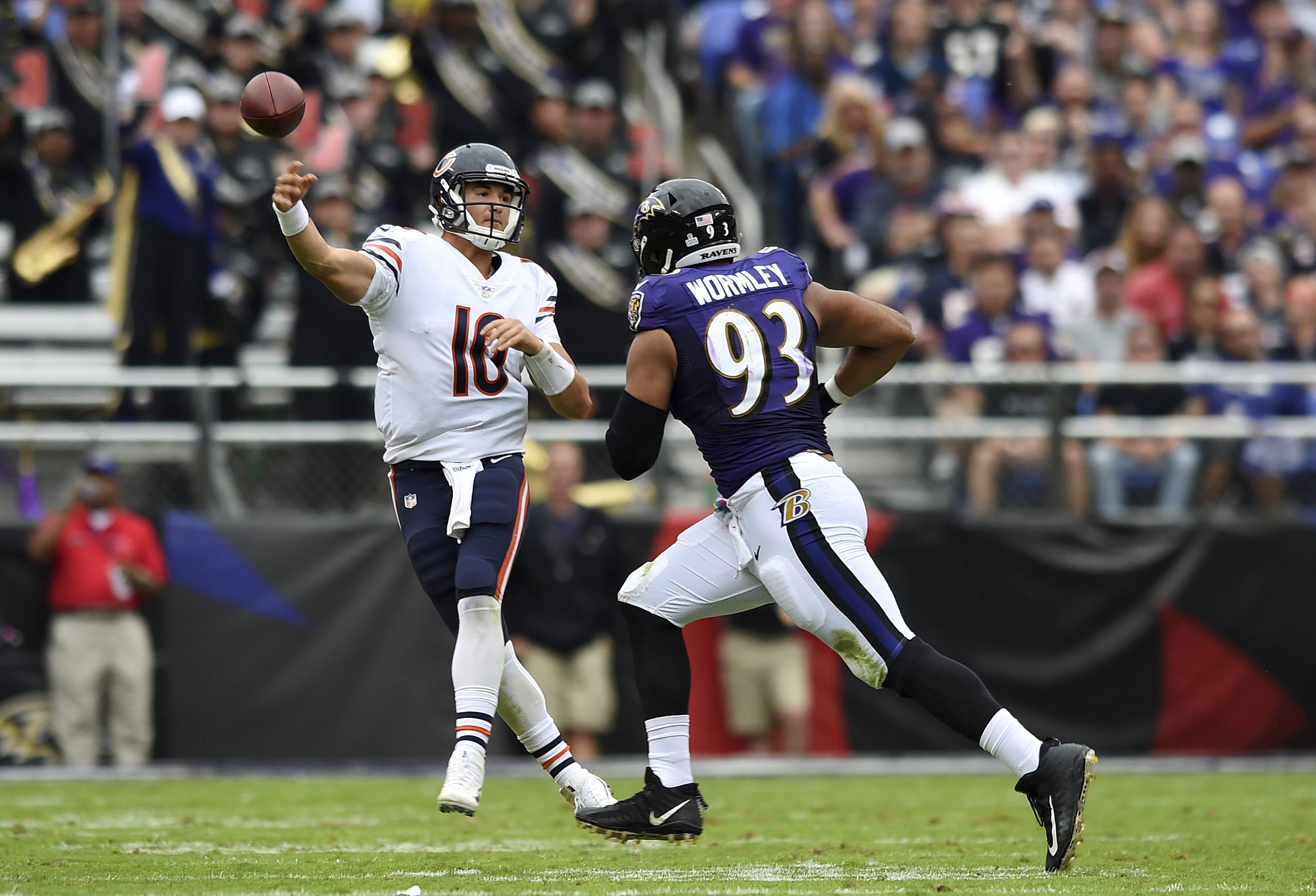 Chicago Bears quarterback Mitchell Trubisky, left, throws to a receiver as he is pressured by Baltimore Ravens defensive end Chris Wormley in the second half of an NFL football game, Sunday, Oct. 15, 2017, in Baltimore.