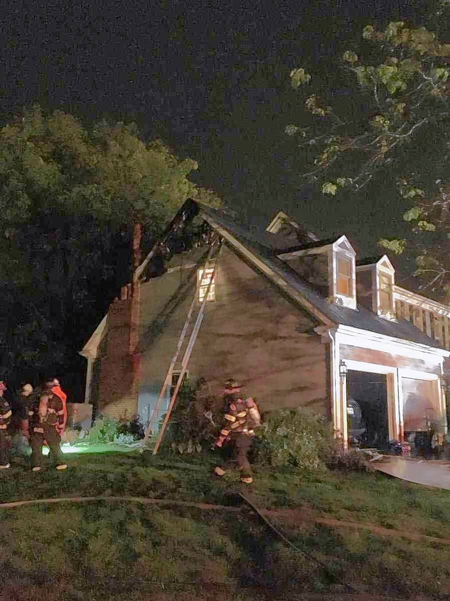 Lake Zurich firefighters battled a blaze sparked by lightning Saturday night in Hawthorn Woods. One resident was injured and the home was declared uninhabitable.