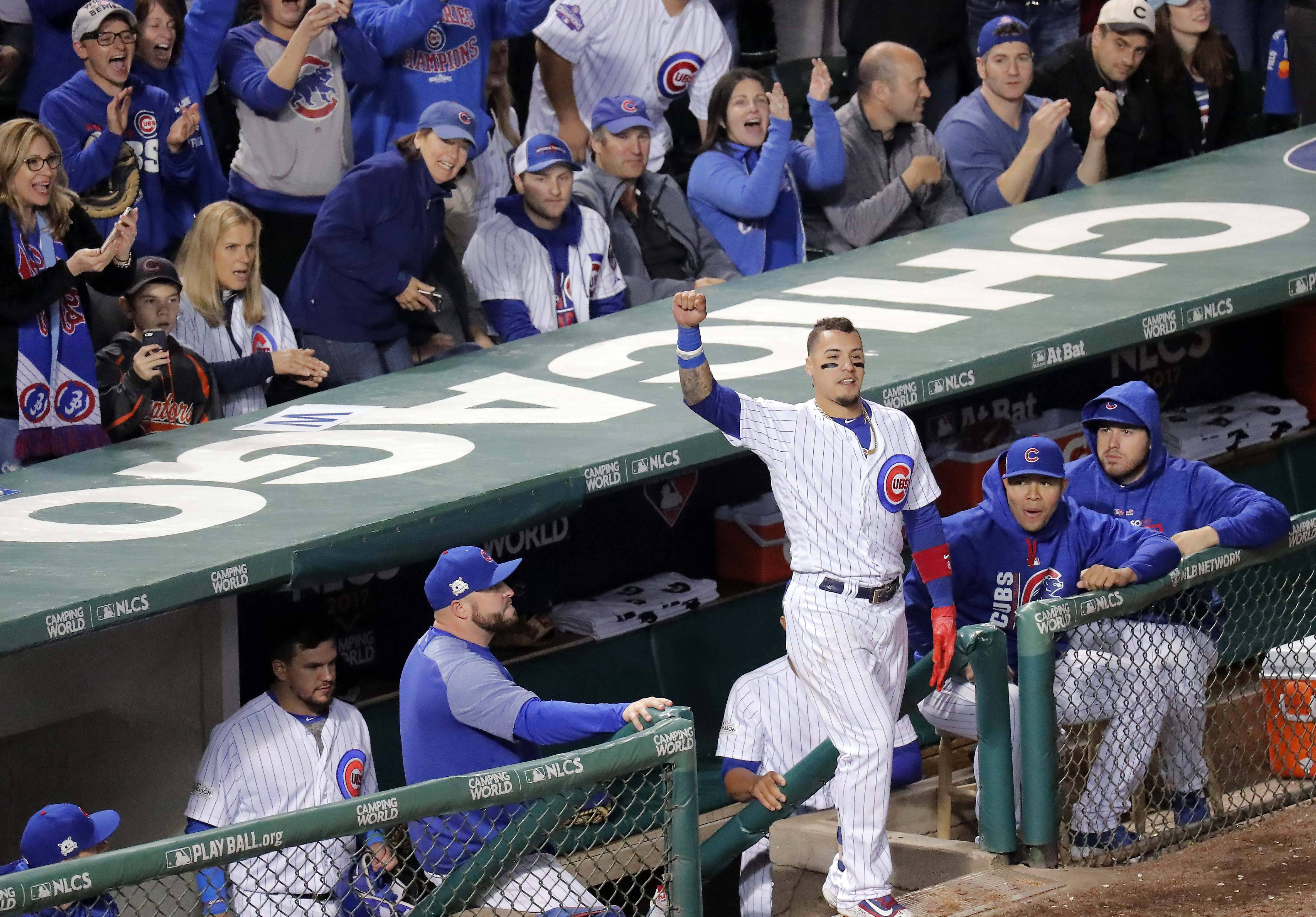 Cubs second baseman Javier Baez comes out for a curtain call after his home run in the fifth inning during Game 4 of the National League Championship Series, Oct, 18 2017, at Wrigley Field in Chicago. The Cubs survived a thriller in Game 4, hanging on to force a Game 5 at Wrigley Field Thursday night.