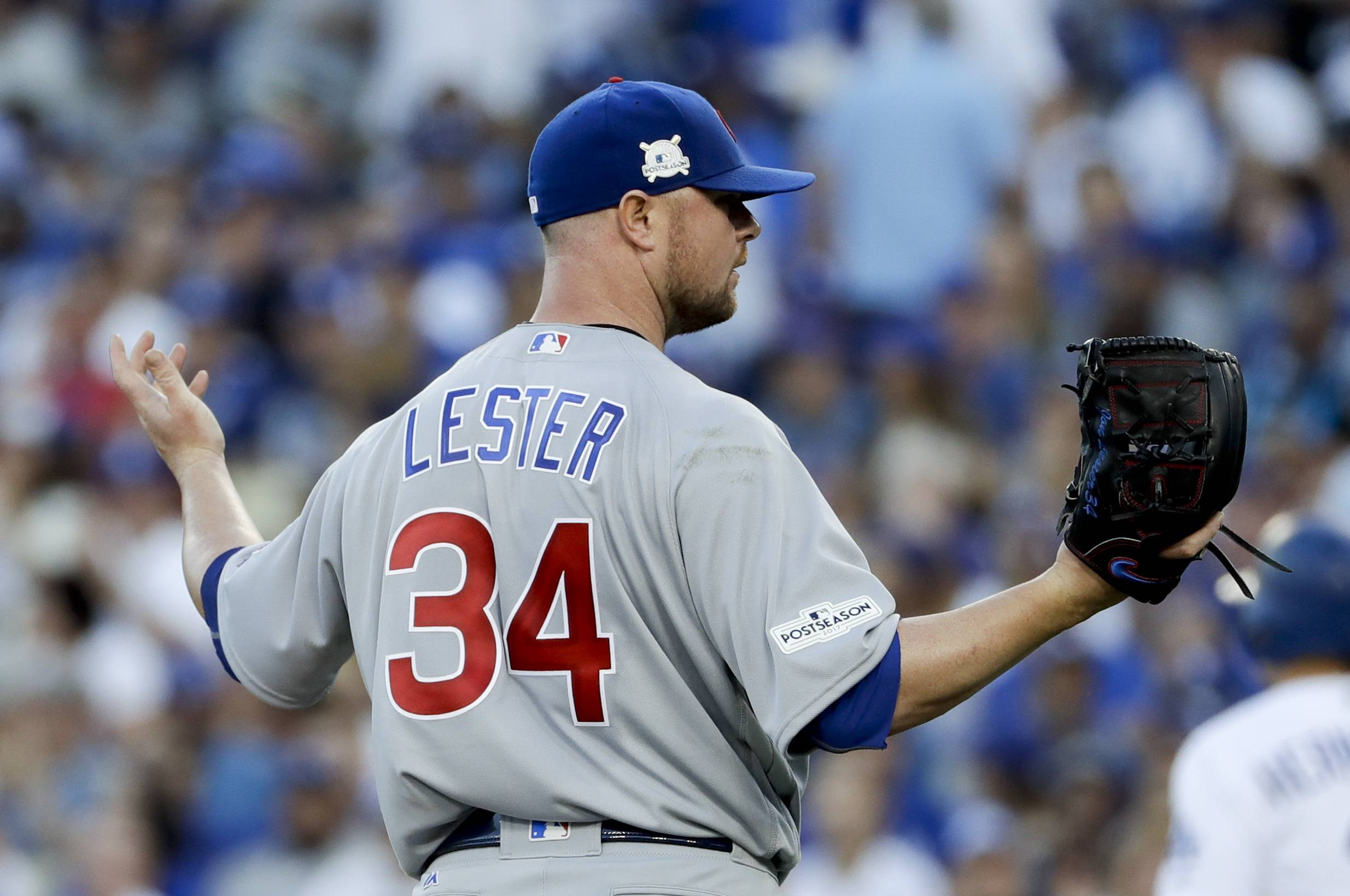 Chicago Cubs starting pitcher Jon Lester reacts after walking Los Angeles Dodgers' Enrique Hernandez during the third inning of Game 2 of baseball's National League Championship Series in Los Angeles, Sunday, Oct. 15, 2017. (AP Photo/Matt Slocum)