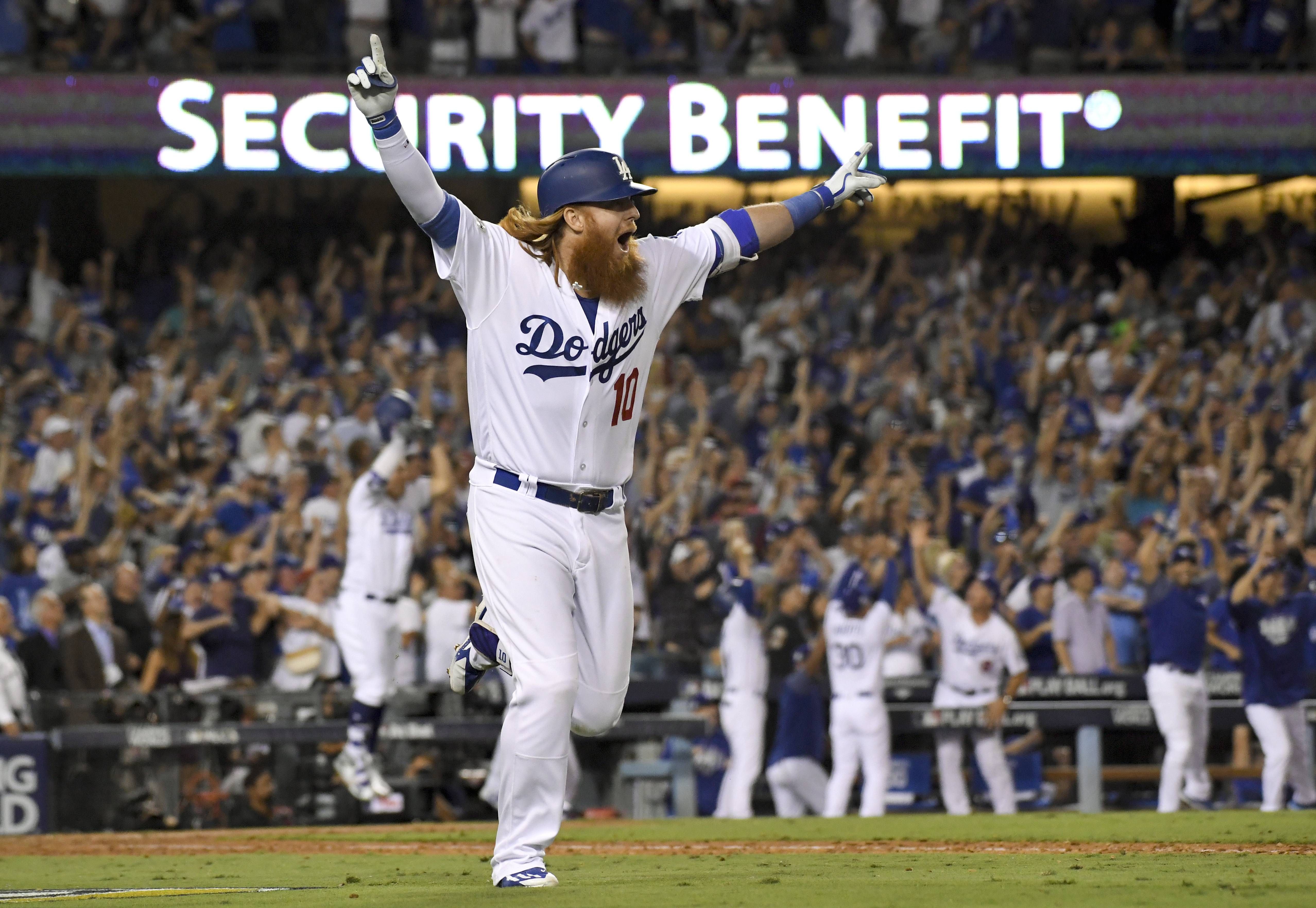 Los Angeles Dodgers' Justin Turner celebrates after a three-run walk off home run against the Chicago Cubs during the ninth inning of Game 2 of baseball's National League championship series in Los Angeles, Sunday, Oct. 15, 2017. (AP Photo/Mark J. Terrill)