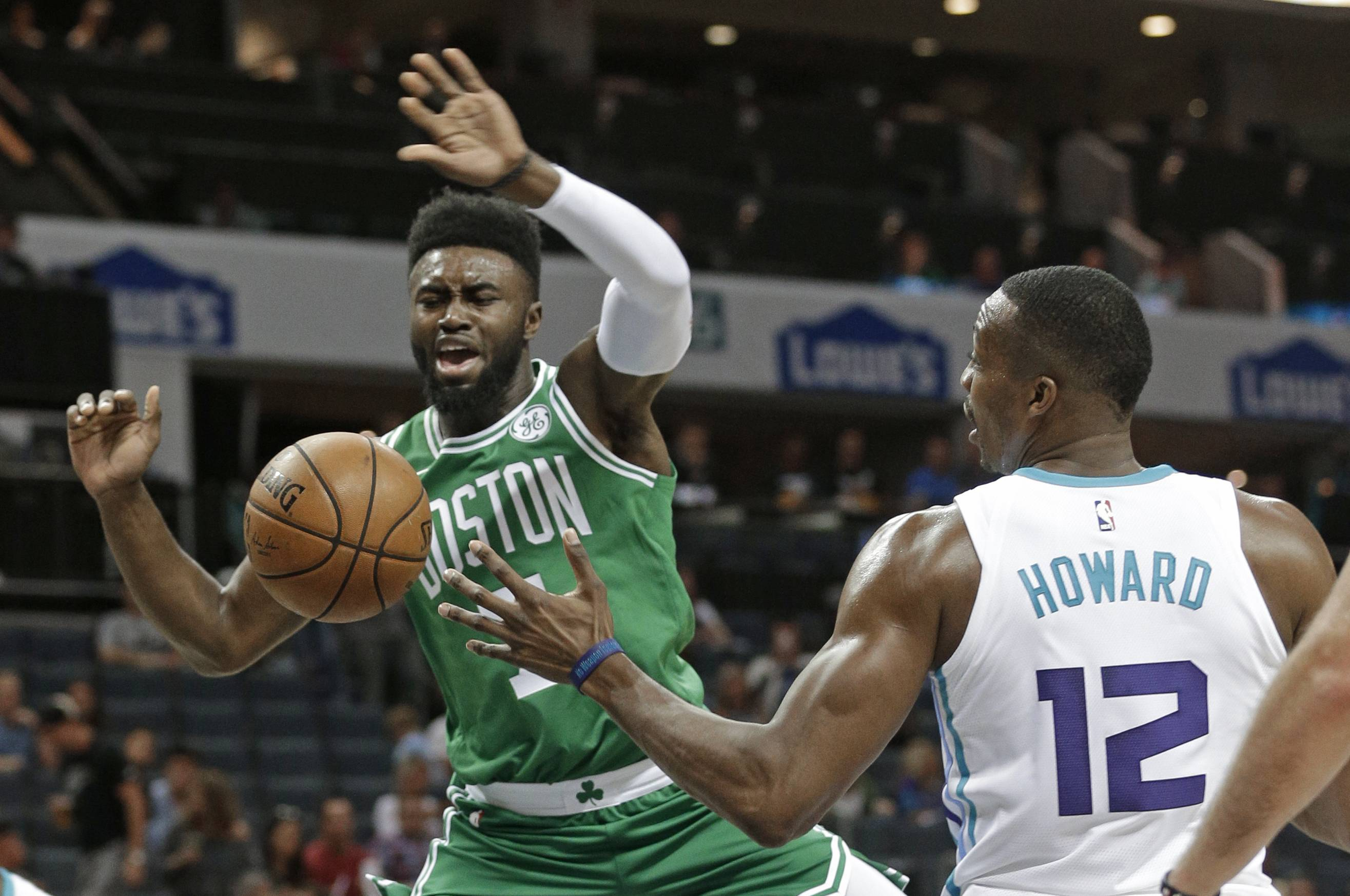 Boston Celtics' Jaylen Brown (7) is fouled by Charlotte Hornets' Dwight Howard (12) in the first half of a preseason NBA basketball game in Charlotte, N.C., Wednesday, Oct. 11, 2017.
