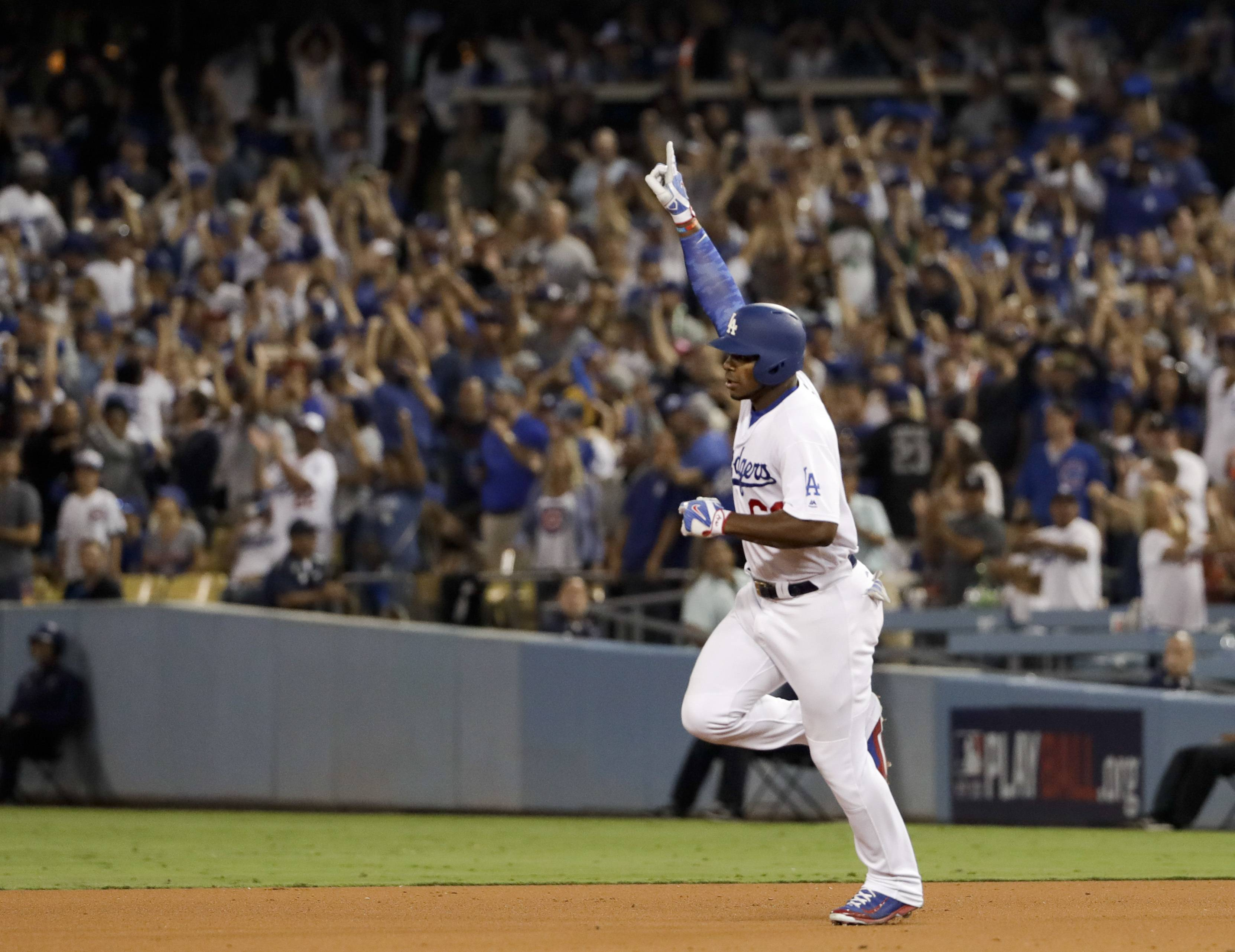 Los Angeles Dodgers' Yasiel Puig celebrates his home run against the Chicago Cubs during the seventh inning of Game 1 of baseball's National League Championship Series in Los Angeles, Saturday, Oct. 14, 2017.