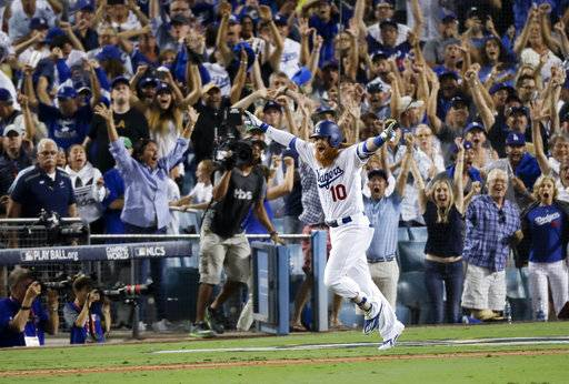 Los Angeles Dodgers' Justin Turner celebrates after a three-run walk off home run against the Chicago Cubs during the ninth inning of Game 2 of baseball's National League Championship Series in Los Angeles, Sunday, Oct. 15, 2017. The Dodgers won, 4-1. (AP Photo/Alex Gallardo)