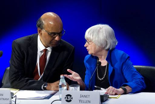 U.S. Federal Reserve Chair Janet Yellen speaks with G30 Chairman Singapore Deputy Prime Minister Tharman Shanmugaratnam during the G30 International Banking Seminar, at Inter-American Development Bank headquarters in Washington, Sunday, Oct. 15, 2017. ( AP Photo/Jose Luis Magana)