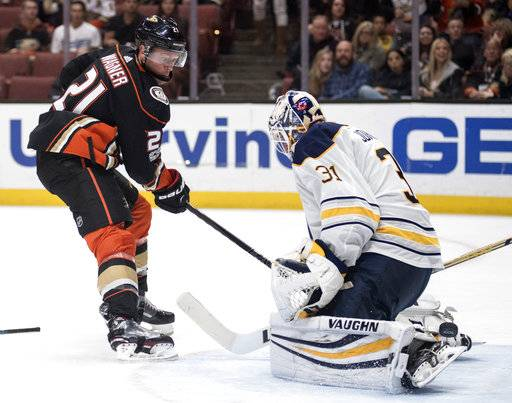 Anaheim Ducks center Chris Wagner, left, scores past Buffalo Sabres goalie Chad Johnson during the second period of an NHL hockey game in Anaheim, Calif., Sunday, Oct. 15, 2017. (AP Photo/Kyusung Gong)