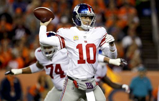 New York Giants quarterback Eli Manning throws a pass during the first half of an NFL football game against the Denver Broncos, Sunday, Oct. 15, 2017, in Denver. (AP Photo/Joe Mahoney)