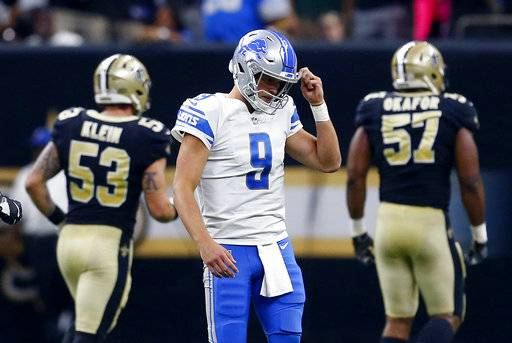 Detroit Lions quarterback Matthew Stafford (9) reacts after fumbling the football and the New Orleans Saints recovered in the first half of an NFL football game in New Orleans, Sunday, Oct. 15, 2017. (AP Photo/Butch Dill)