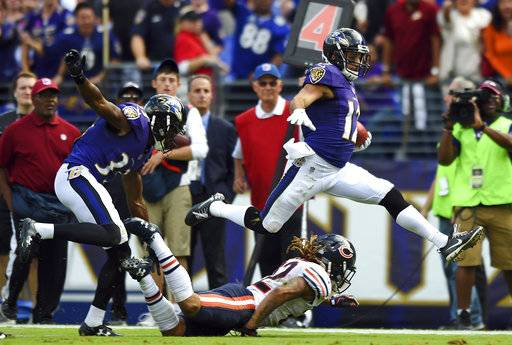 Baltimore Ravens wide receiver Michael Campanaro, right, jumps over Chicago Bears cornerback Cre'von LeBlanc as he runs for a touchdown on a punt return in the second half of an NFL football game, Sunday, Oct. 15, 2017, in Baltimore.