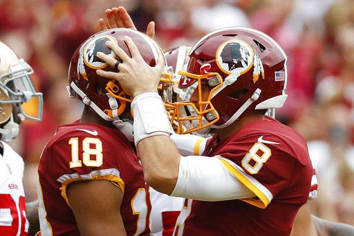 Washington Redskins quarterback Kirk Cousins (8) congratulates wide receiver Josh Doctson (18) after a touchdown during the first half of an NFL football game against the San Francisco 49ers in Landover, Md., Sunday, Oct. 15, 2017. (AP Photo/Alex Brandon)