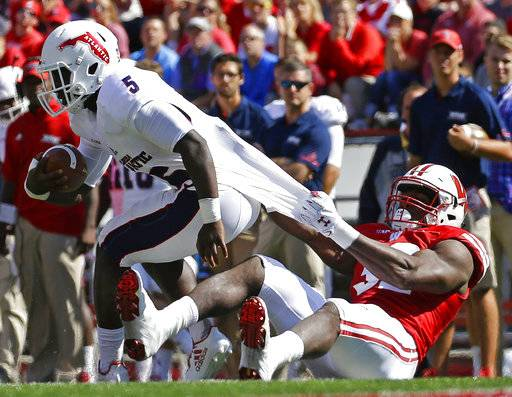 FILE - In this Sept. 9, 2017, file photo, Wisconsin's Leon Jacobs drags Florida Atlantic's Devin Singletary to the ground during an NCAA college football game in Madison, Wis. Jacobs has finally found a home at outside linebacker, and it is paying off for No. 5 Wisconsin. (AP Photo/Aaron Gash, File)