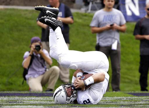 FILE - In this Oct. 7, 2017, file photo, Penn State quarterback Tommy Stevens catches a touchdown pass during the first half of an NCAA college football game against Northwestern in Evanston, Ill.. Penn State is No. 2 in The Associated Press College football poll behind now unanimous No. 1 Alabama after a wild weekend of upsets gave the Top 25 a major makeover. (AP Photo/Nam Y. Huh, File)