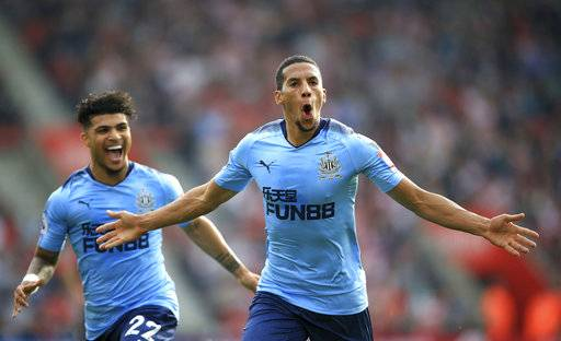 Newcastle United's Isaac Hayden, right, celebrates scoring his side's first goal of the game with teammate DeAndre Yedlin during their English Premier League soccer match at St Mary's, Southampton, England, Sunday, Oct. 15, 2017. (John Walton/PA via AP)