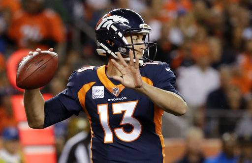 Denver Broncos quarterback Trevor Siemian throws a pass during the first half of an NFL football game against the New York Giants, Sunday, Oct. 15, 2017, in Denver. (AP Photo/Jack Dempsey)