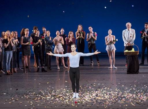 This Oct. 15, 2017 photo released by the New York City Ballet shows dancer Robert Fairchild taking a bow during his final performance with the ballet on Sunday in New York. Fairchild, a dancer and a Tony-nominated actor, is leaving the ballet company to concentrate on musical theater. (Paul Kolnik/New York City Ballet via AP)