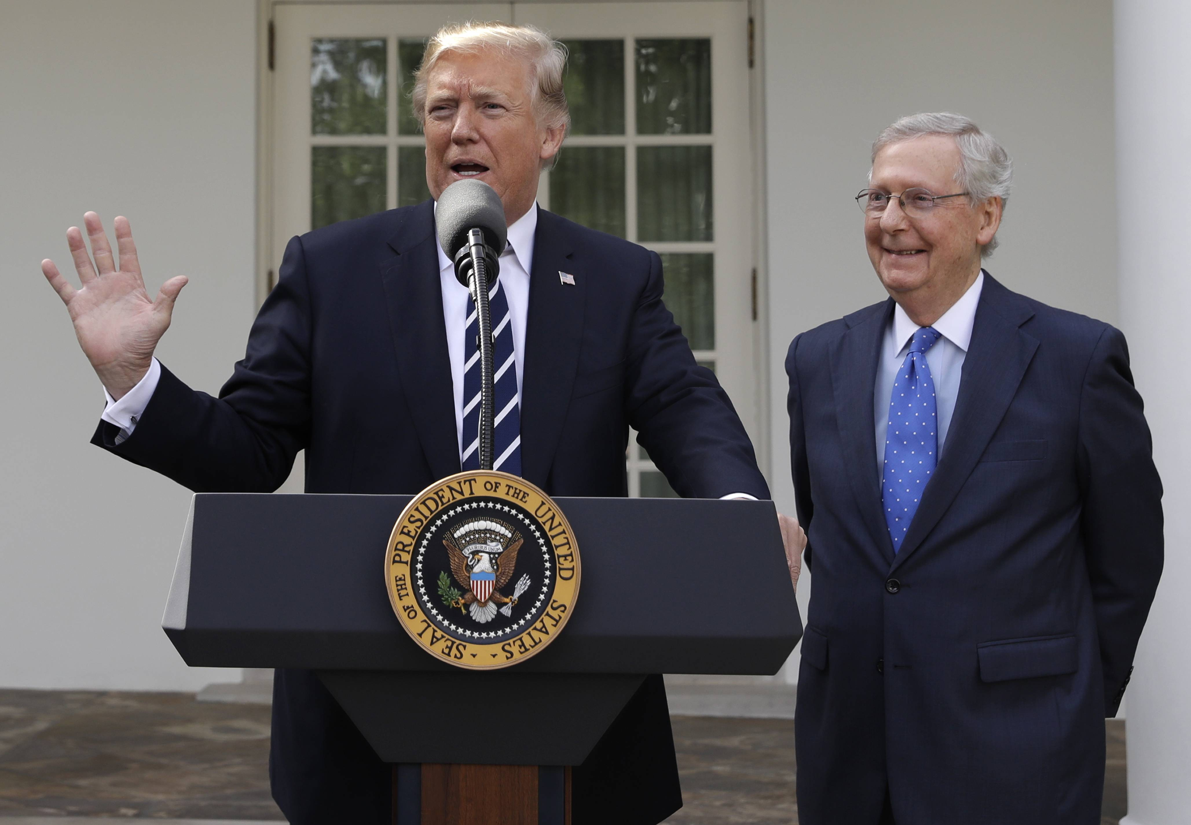 President Donald Trump answers questions with Senate Majority Leader Mitch McConnell, R-Ky., in the Rose Garden after their meeting at the White House, Monday, Oct. 16, 2017, in Washington.