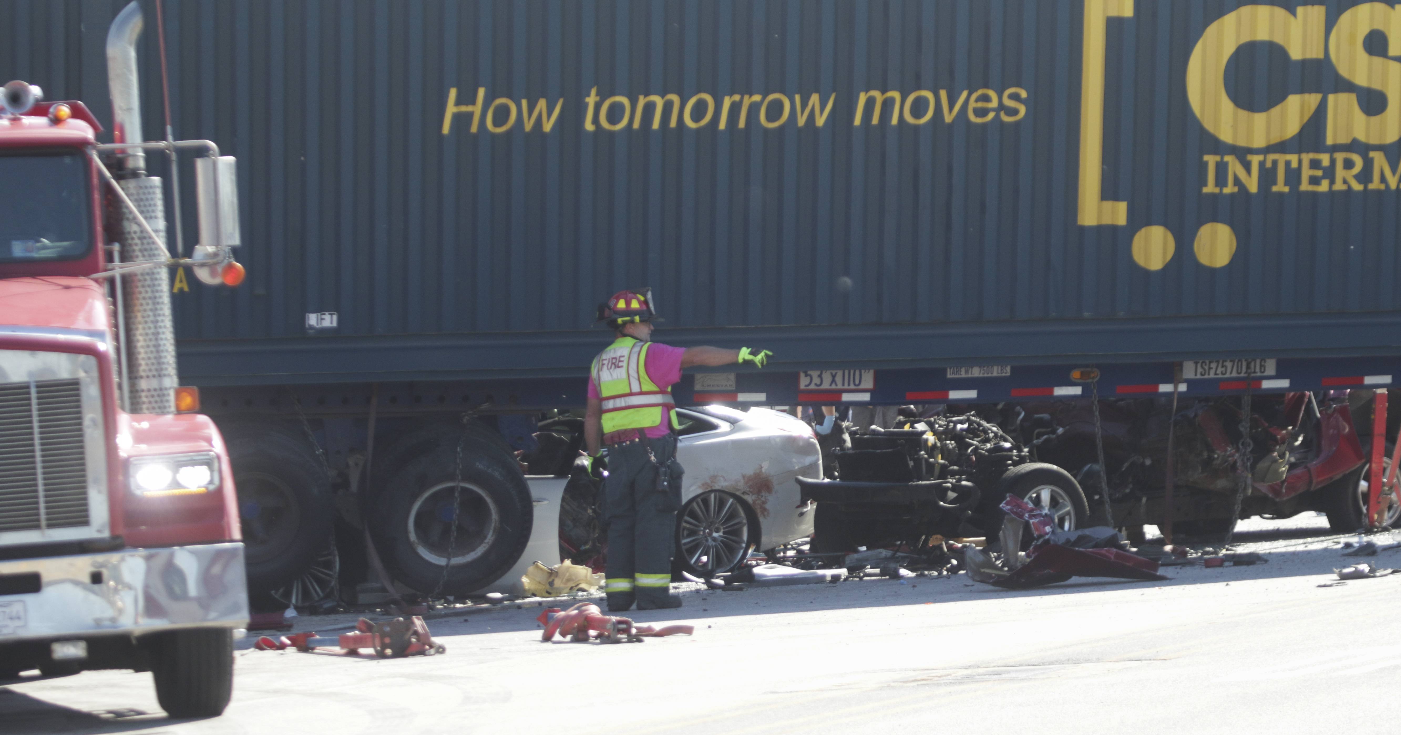 Two cars are pinned under a semitrailer truck Monday afternoon on Orchard Road and Interstate 88 on the Aurora-North Aurora border.