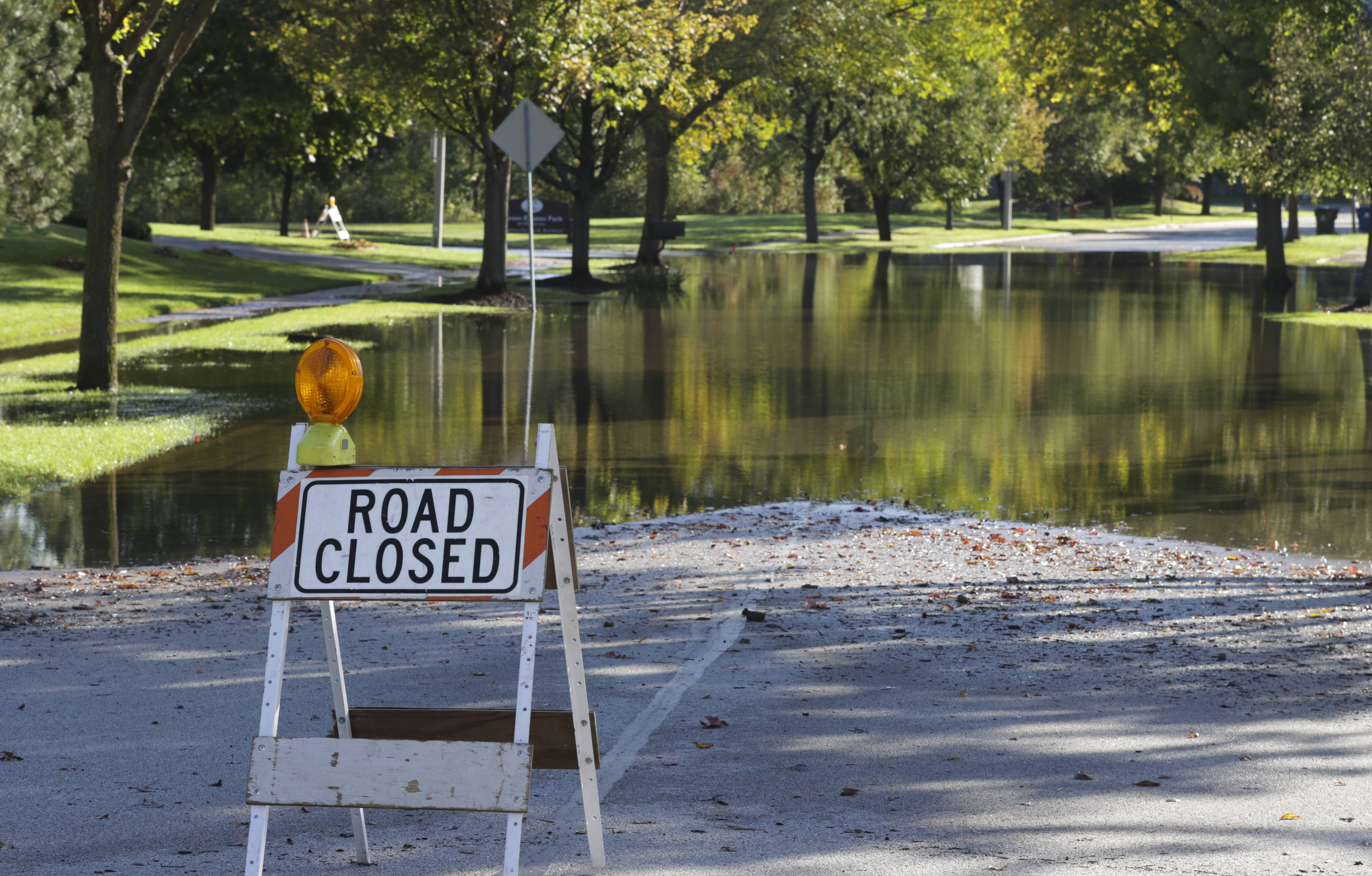 Part of Dunrobin Road in Naperville remained closed Monday morning because of high water after weekend storms dumped roughly 8 inches of rain on the area.
