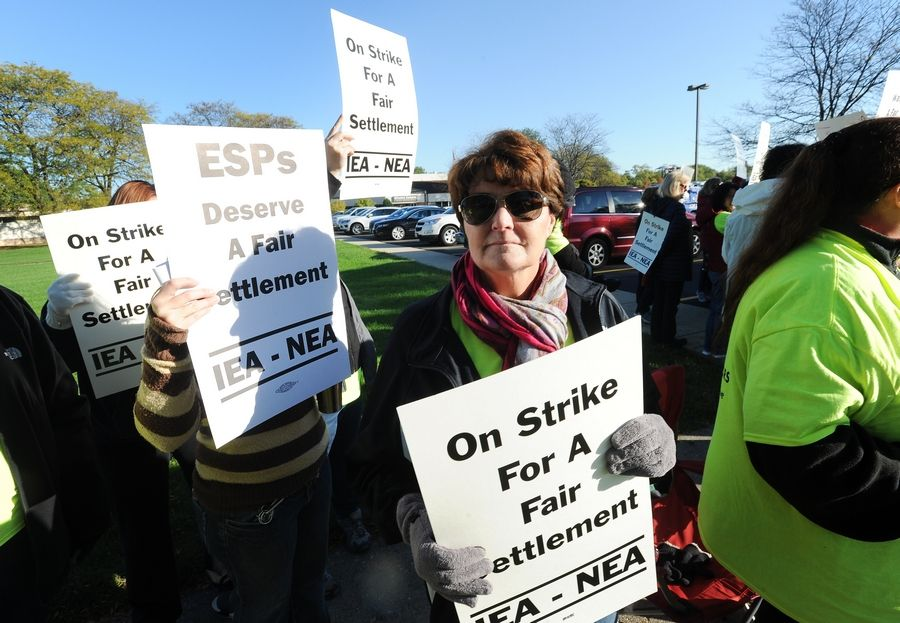 Nancy Roock, who works at Winston Campus Elementary School in Palatine, with other strikers there Monday in Palatine. The strike involves 454 members in the Educational Support Personnel Association who have been without a contract since July 1.