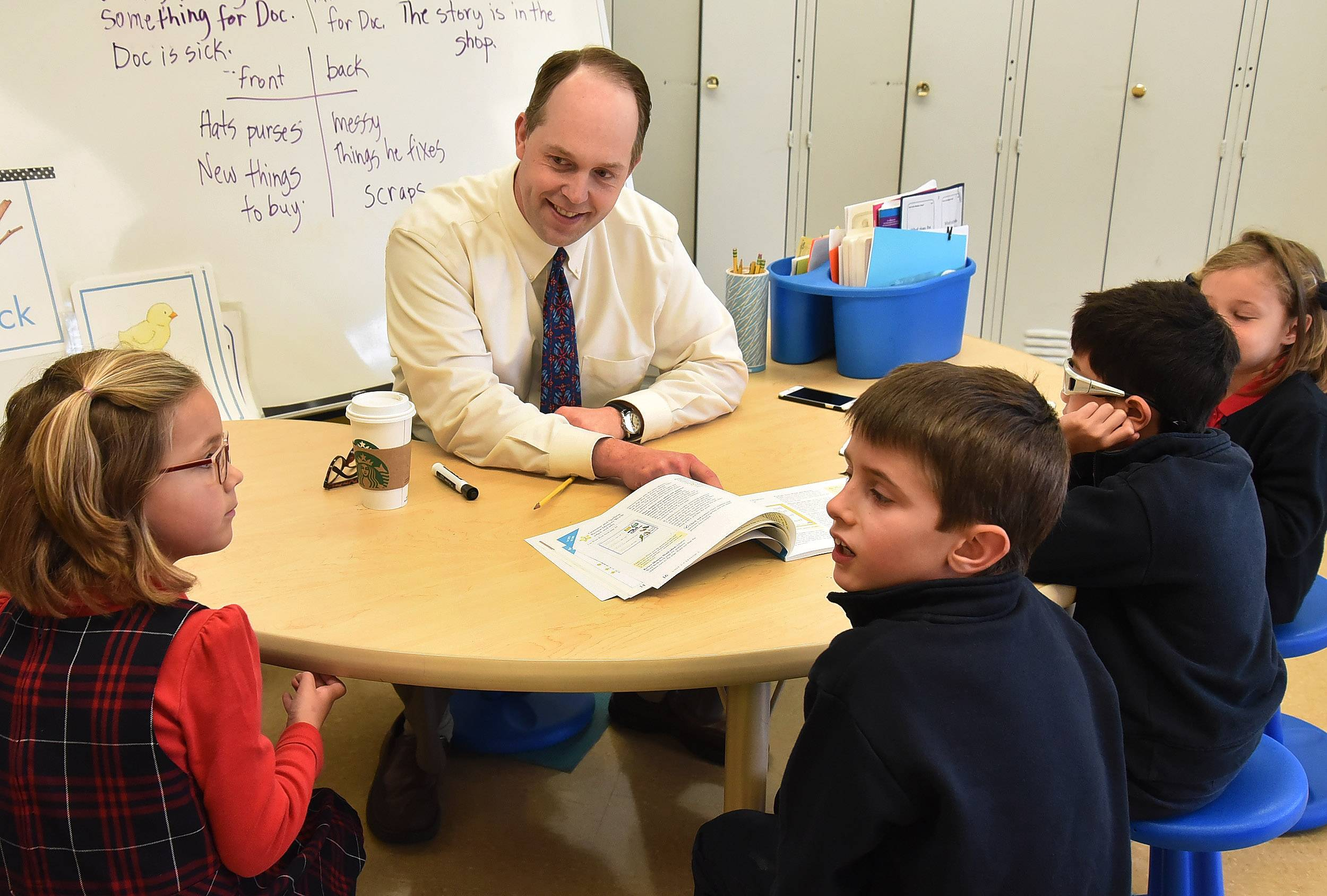 Archdiocese of Chicago Superintendent of Schools Jim Rigg visits with first- and second-graders Thursday at St. Thomas of Villanova school in Palatine.