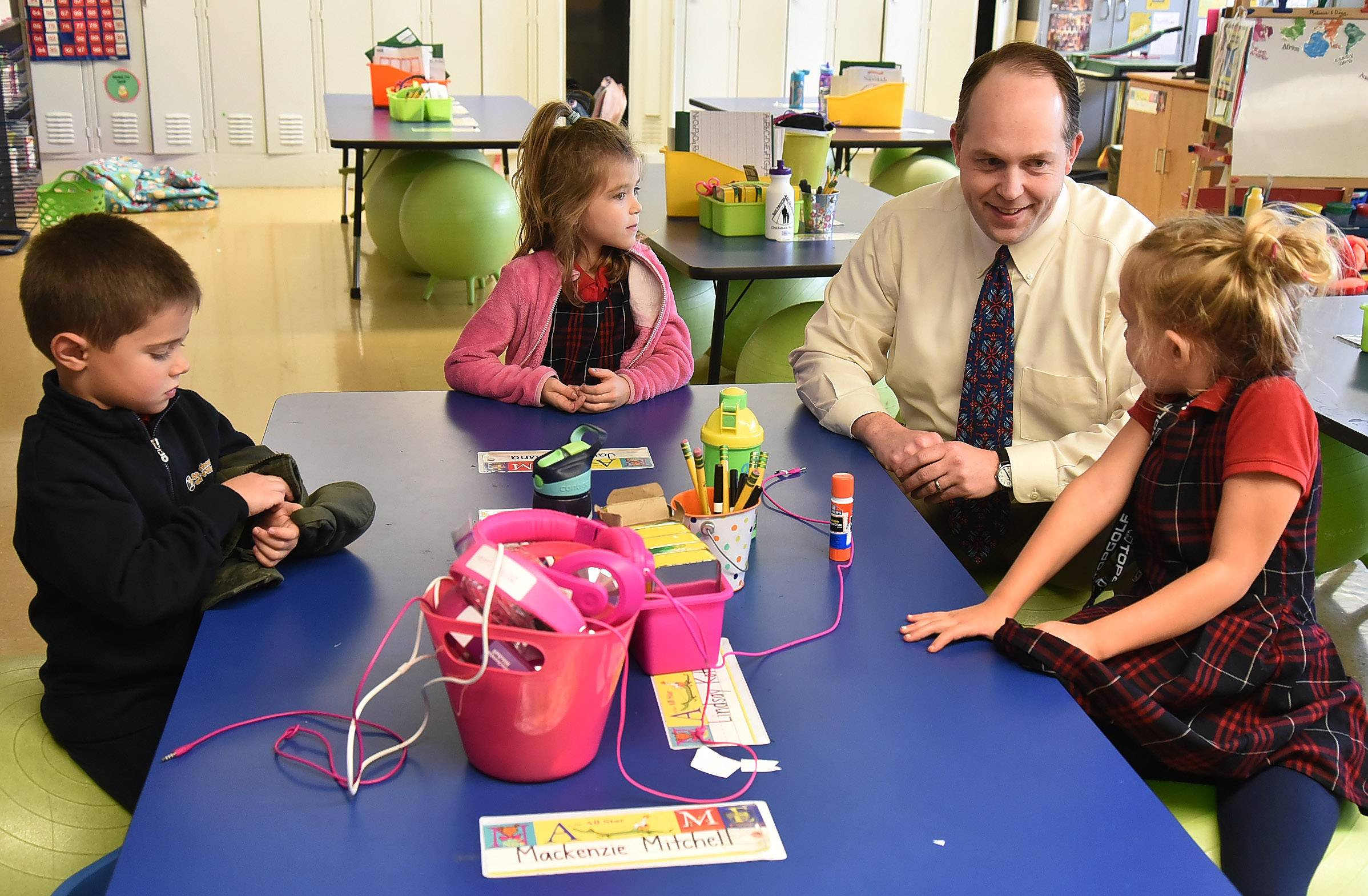 Archdiocese of Chicago Superintendent of Schools Jim Rigg visits with kindergartners, from left, Johnny Meyers, McKenzie Mitchell and Amelia Rembisz at St. Thomas of Villanova school in Palatine Thursday.