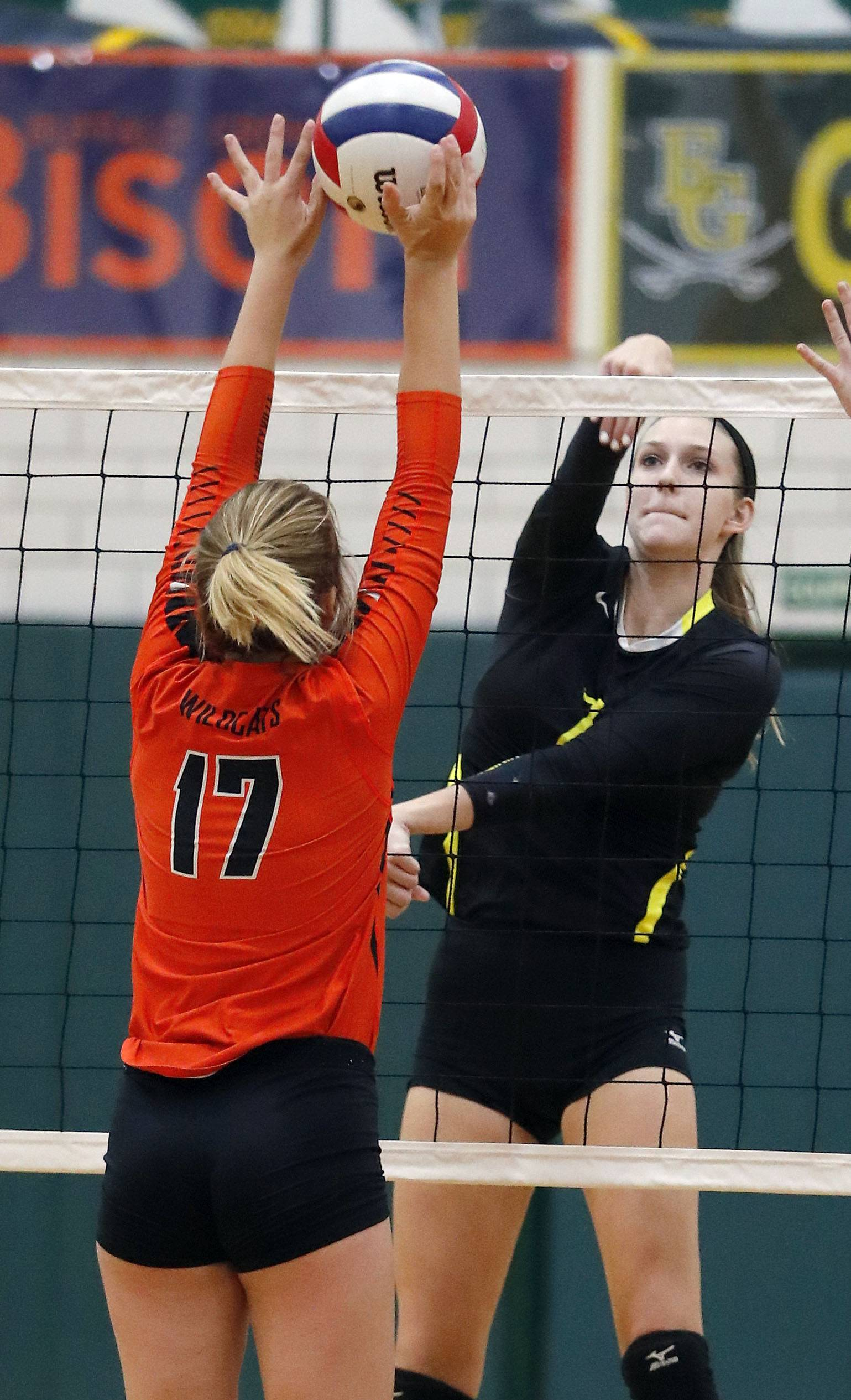 Fremd's Jules Tangney, right, spikes one at Libertyville's Anna Valente on Monday at Fremd.