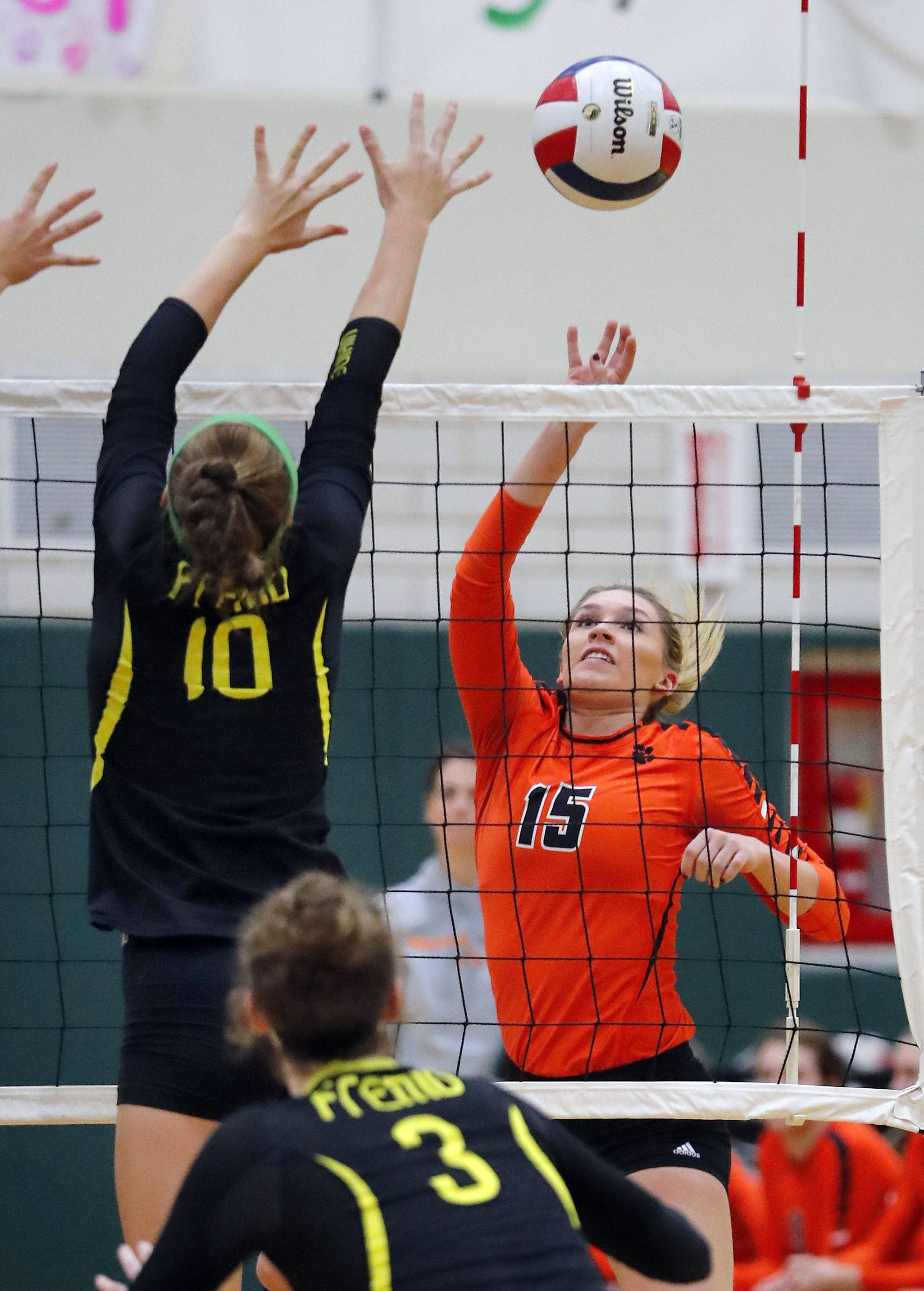 Libertyville's Madison O'Brien and Fremd's Peyton Hooker meet at the net Monday at Fremd.