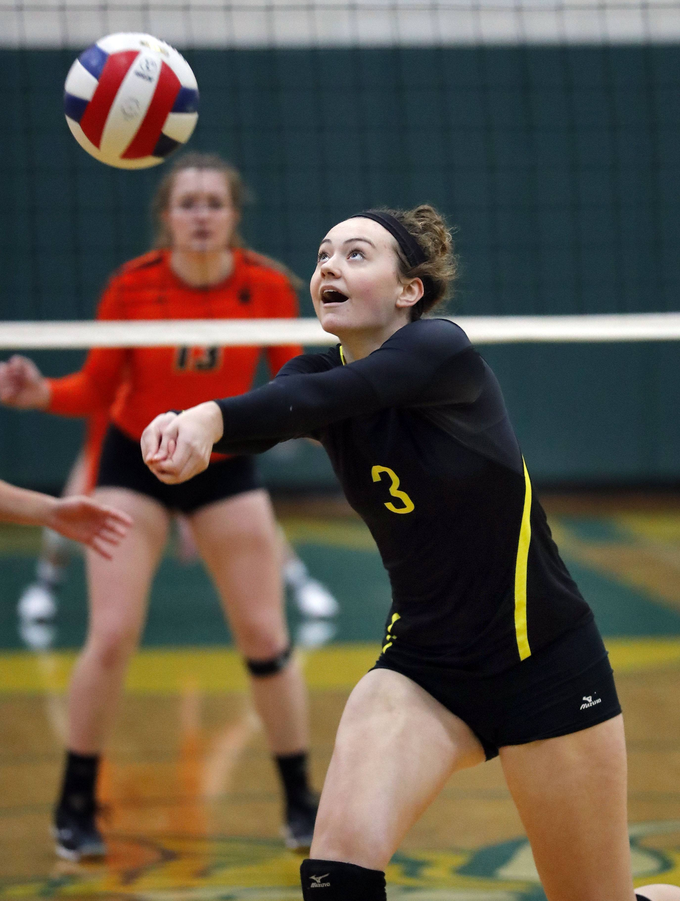 Fremd's Sarah Straup volleys against Libertyville on Monday at Fremd.