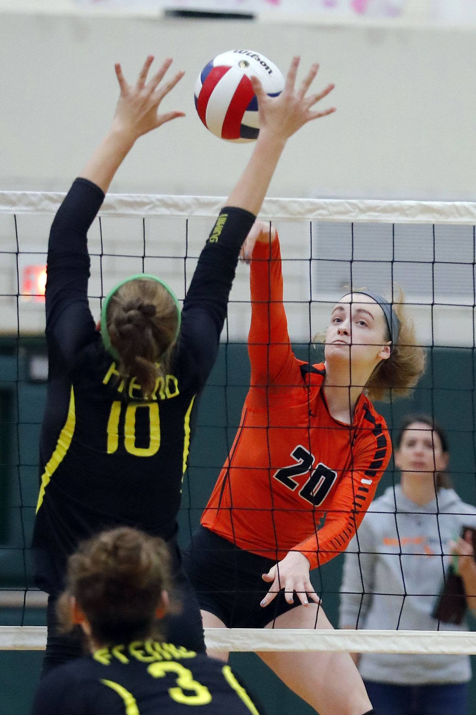 Libertyville's Kellie Hopper, right, spikes one at Fremd's Peyton Hooker Monday at Fremd.