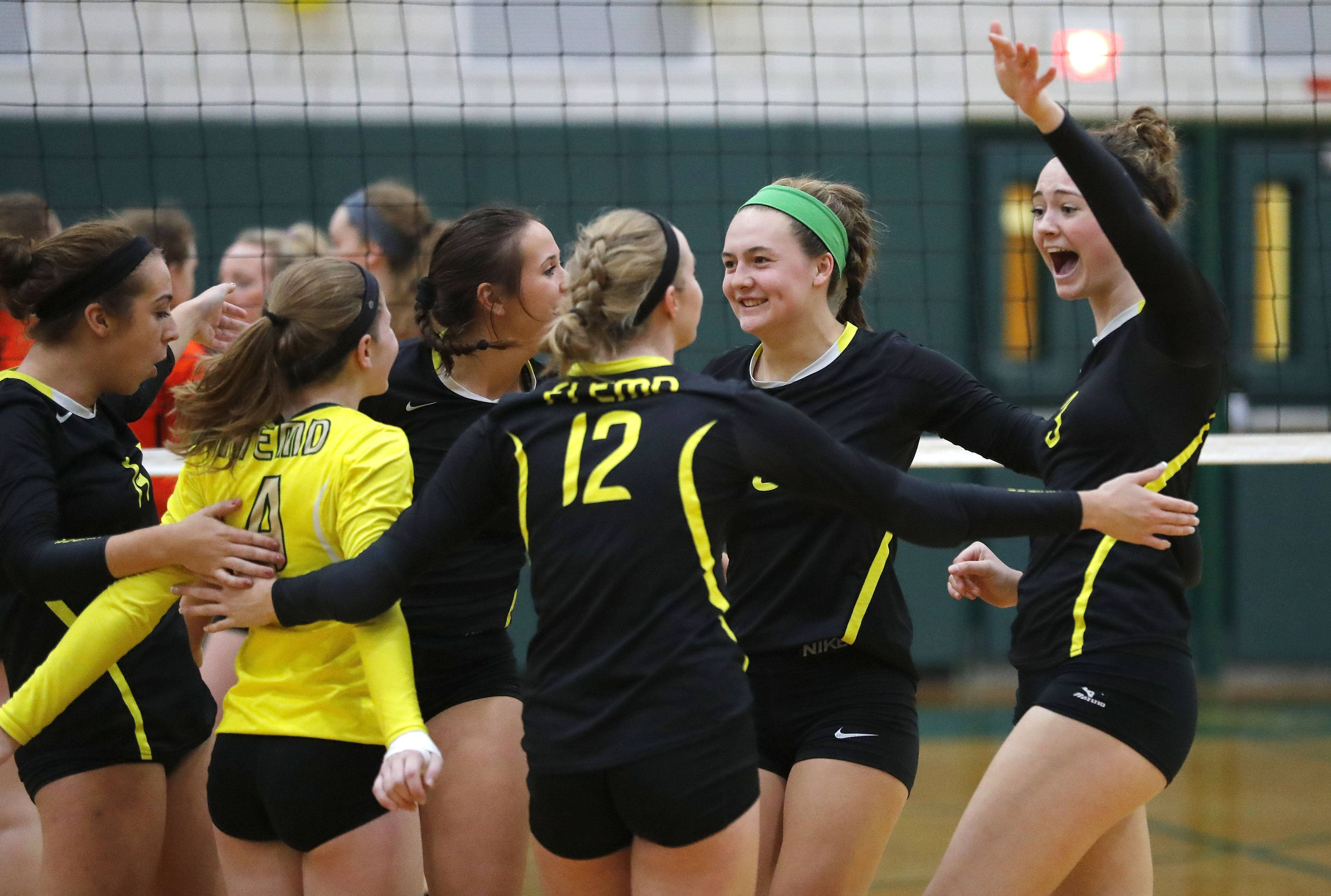 Fremd players celebrate during against Libertyville on Monday at Fremd.