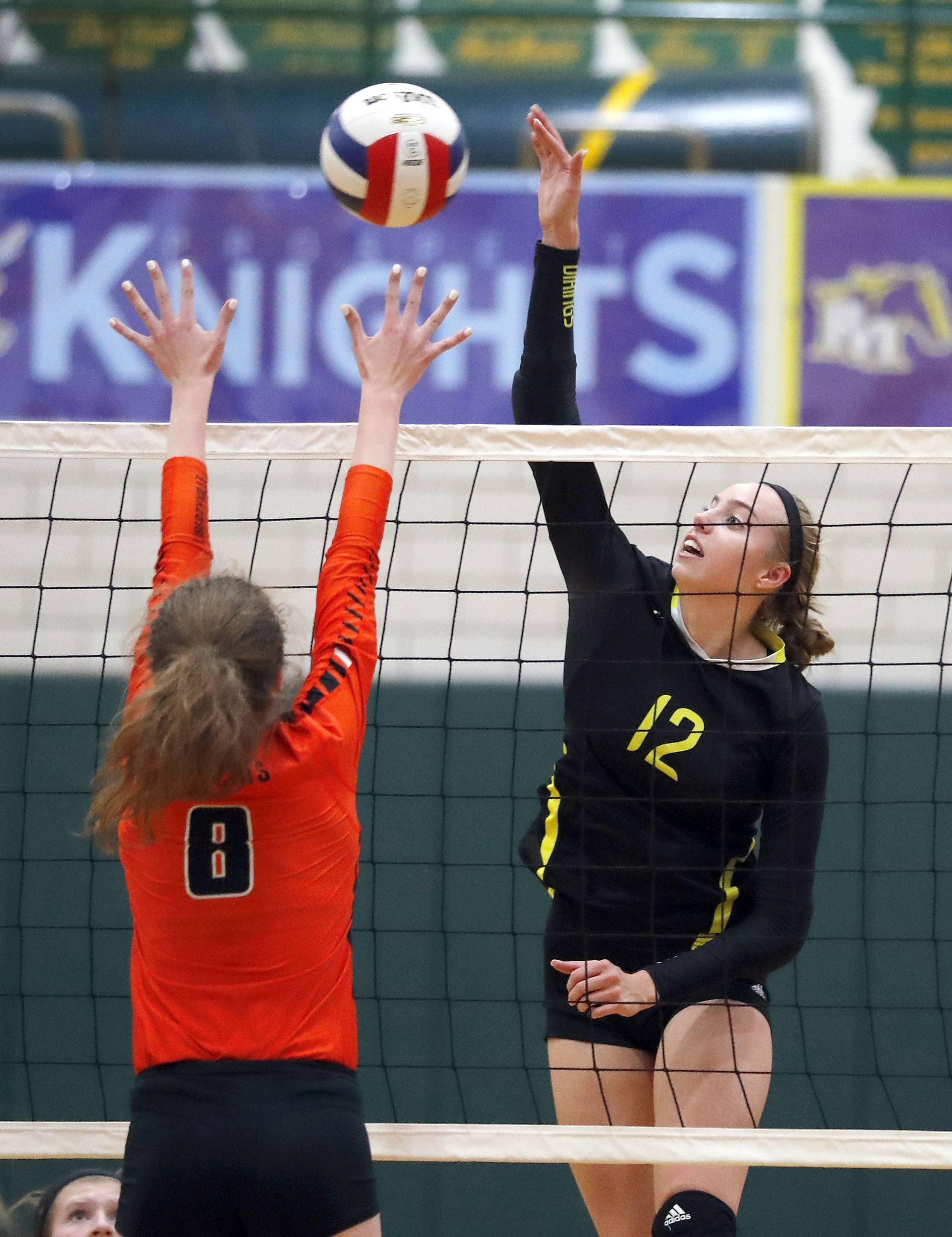 Fremd's Heidi Sayre, right, spikes one at Libertyville's Kailey Christianson on Monday at Fremd.