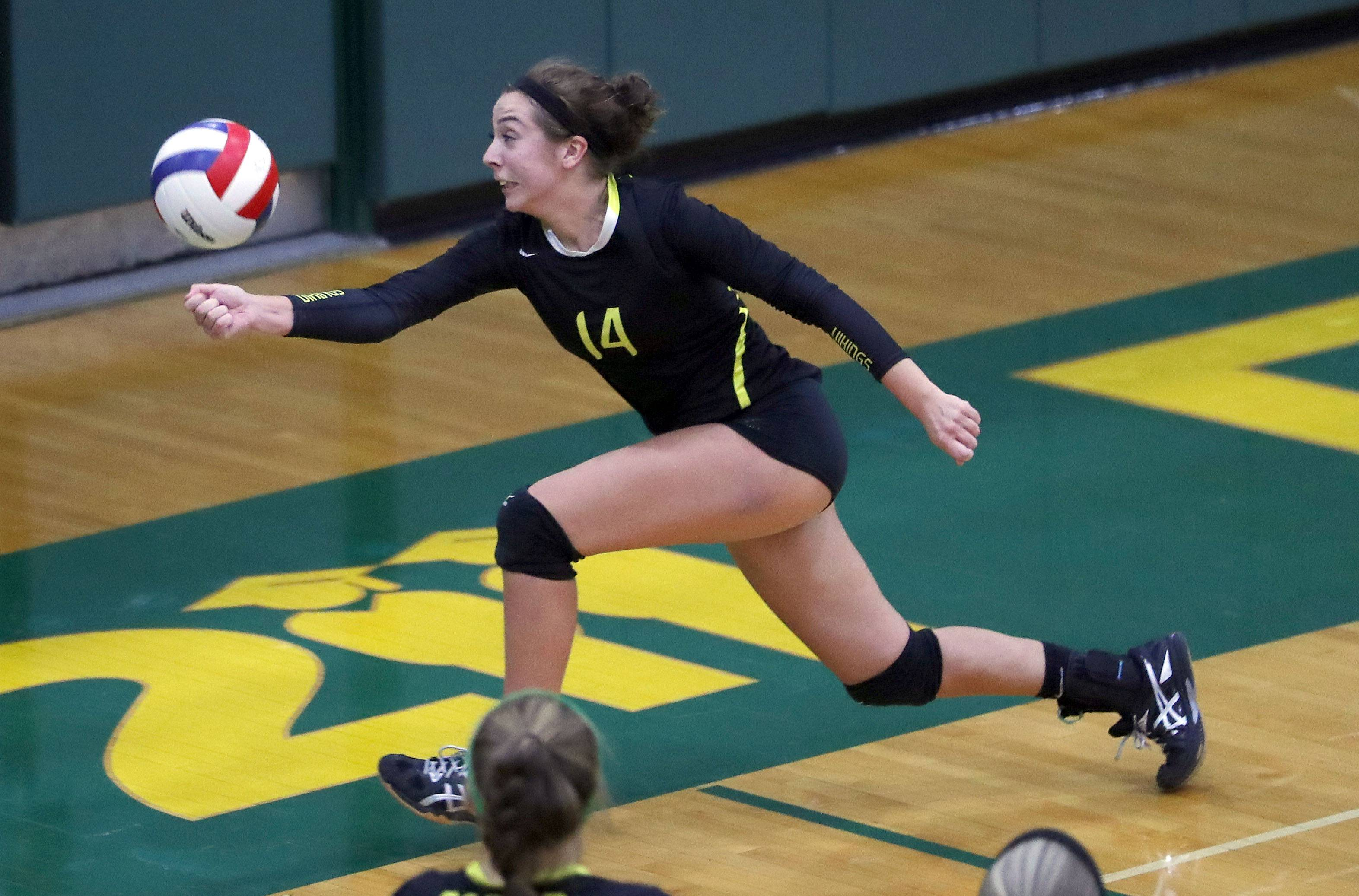 Fremd's Jess Rizzo goes for a loose ball against Libertyville on Monday at Fremd.