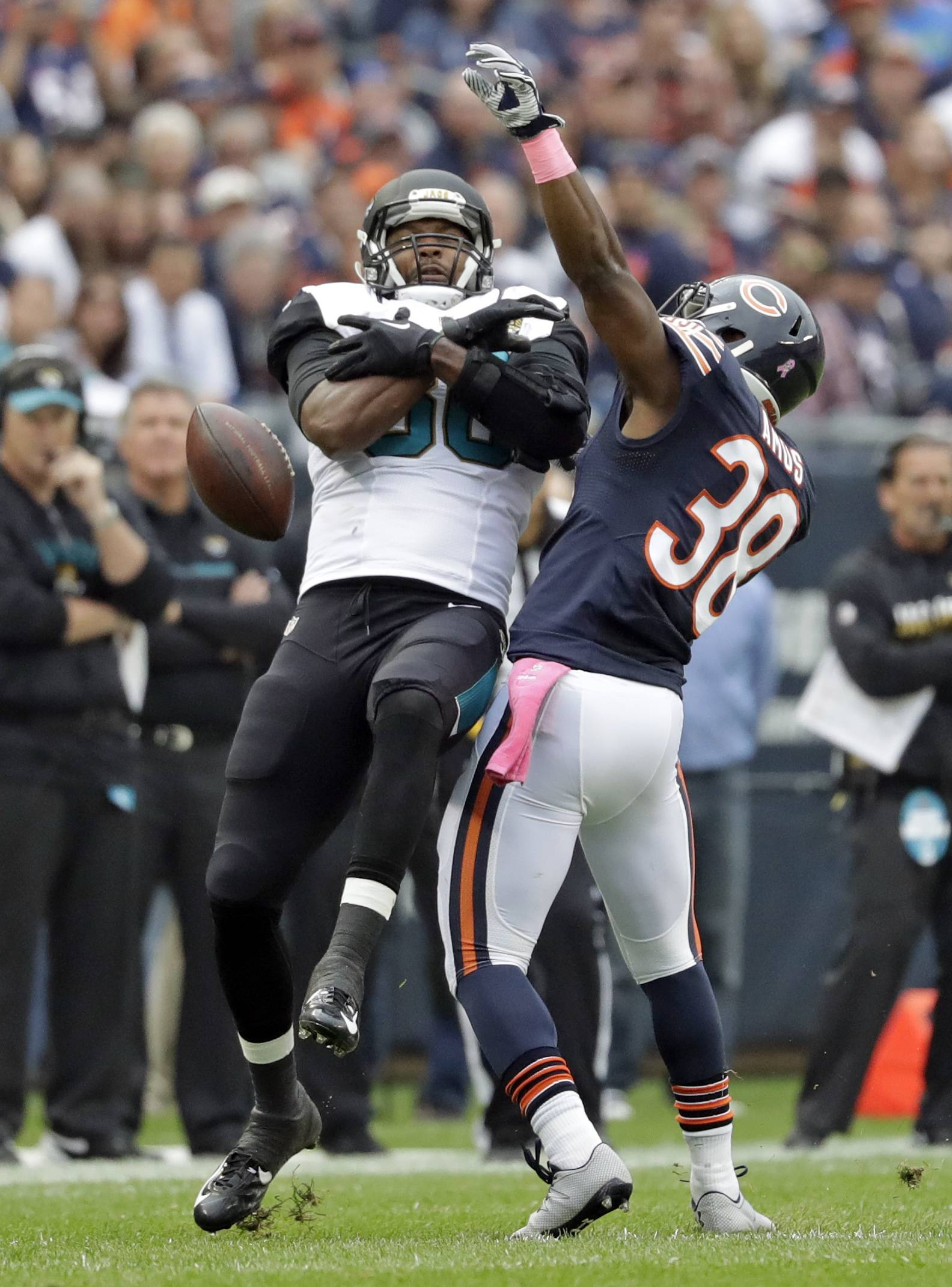 Chicago Bears free safety Adrian Amos (38) breaks up a pass intended for Jacksonville Jaguars tight end Julius Thomas (80) during the first half of an NFL football game in Chicago, Sunday, Oct. 16, 2016.